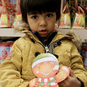 Holding his Gingerbread Man!